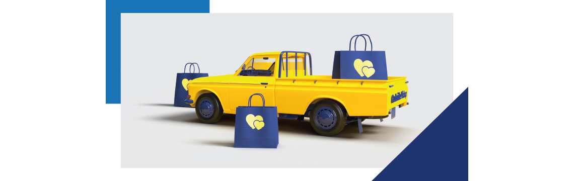 yellow truck with blue details and blue shopping bags