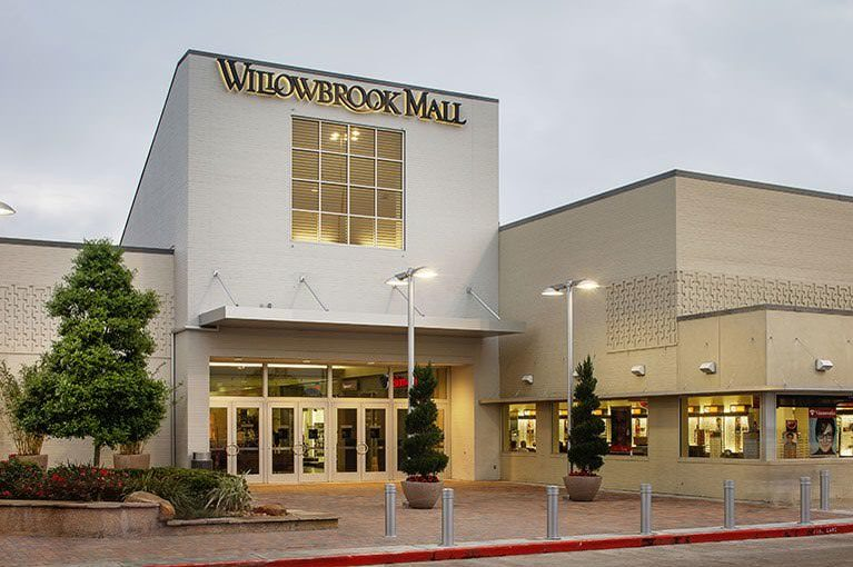 At dusk, the entrance to Willowbrook Mall is lit up welcoming shoppers.